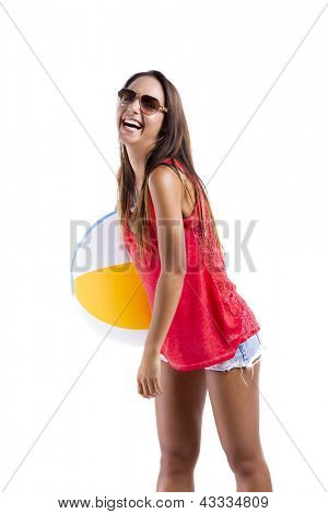Happy beautiful woman whit sunglasses and holding a beach ball, isolated over white a background