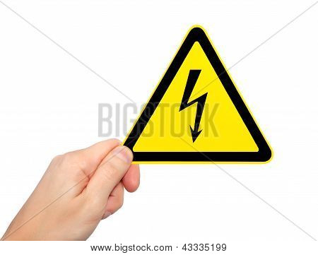 Isolated Male Hand Holding Sign Of Danger High Voltage Symbol