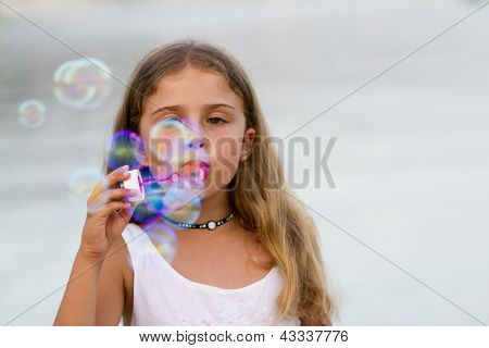 Summer joy - Soap bubbles - lovely girl blowing bubbles, happy child concept