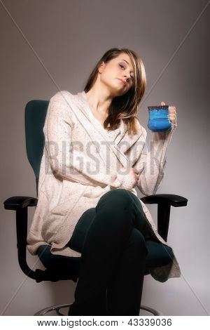 Pretty Woman Daydreaming While Holding A Tee Cup