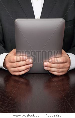 Businessman reading news on digital tablet