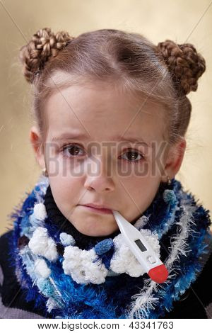 Little girl with red eyes having the flu - checking temperature