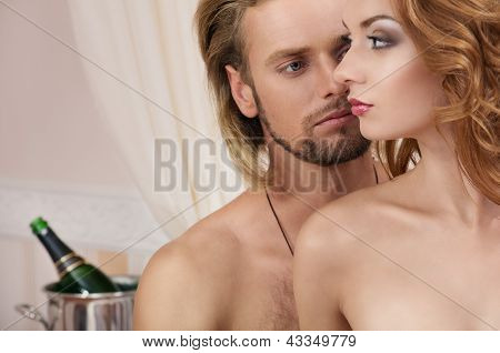 Young couple at the hotel, lovers