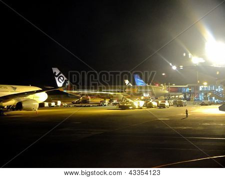 Planes At Airport At Night