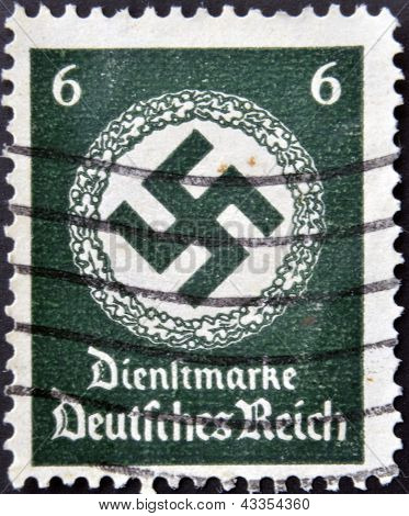 A postage stamp printed in Germany shows the Swastika of the German Reich