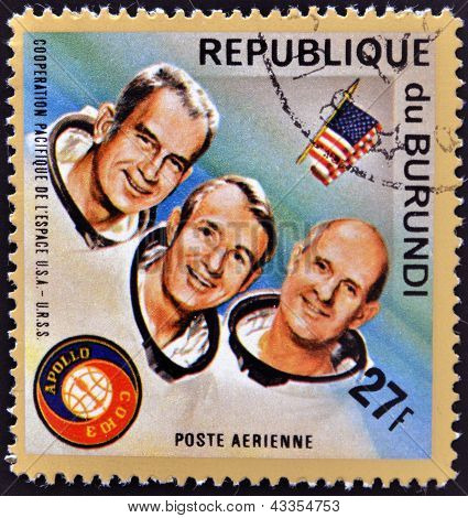 stamp printed in Burundi shows American astronauts Jack R. Lousma Ronald Evans and Alan Bean