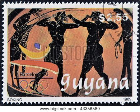 A stamp printed in Guyana dedicated to Barcelona '92 shows detail of Greek ceramics with boxers