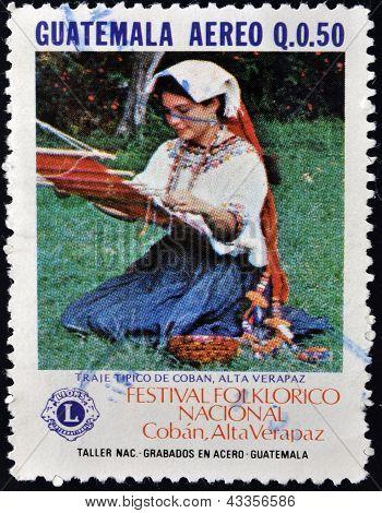 A stamp printed in Guatemala shows Costume of Coban Alta Veracruz