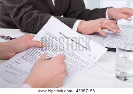 Hands of the woman signature document sitting on desk