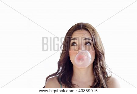 Cute girl making a bubble with gum