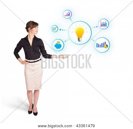 Young woman presenting light bulb with colorful graphs and diagrams isolated on white
