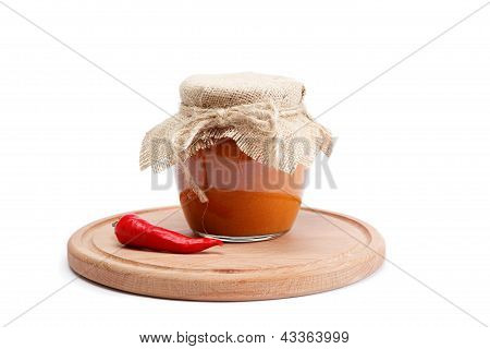 Squash Caviar In Glass Jar And Spices On A Wooden Board With White Background.