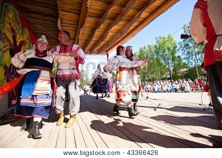 VINNICI, LENINGRAD REGION, RUSSIA - JUNE 10: Local people during celebrate the annual holiday Vepsian national culture Tree of Life (vepssk.Elo-pu), June 10, 2012 in the village Vinnici, Russia.
