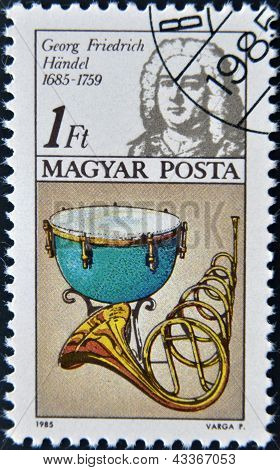 stamp printed in Hungary shows Frederic Handel kettle drum horn
