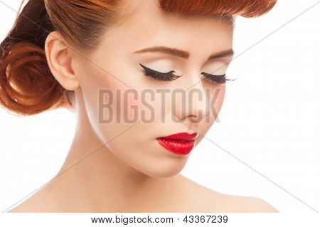 Closeup portrait of  beautiful pinup woman with vintage makeup and hairstyle. Isolated on white background