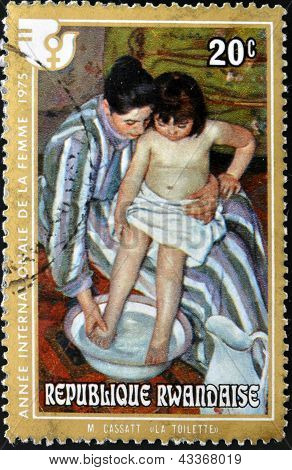 RWANDA - CIRCA 1975: A stamp printed in Rwanda shows the work the bath by Mary Cassatt, circa 1975