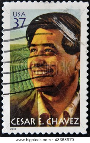 A stamp printed in USA shows Cesar E. Chavez