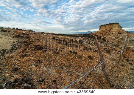 Rocky Desert And Fence