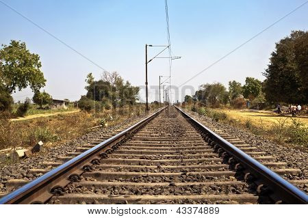 Indian Railroad Track With Overhead Cables