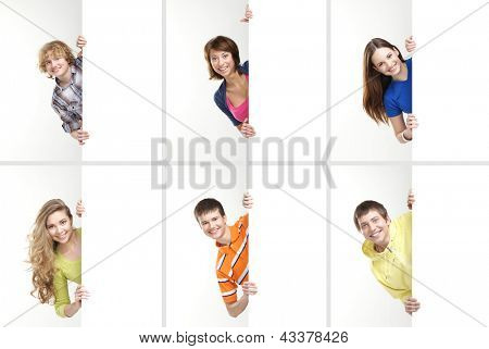 Set of teenagers with a giant, blank, white billboard