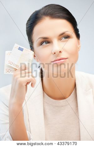 picture of dreaming businesswoman with cash money