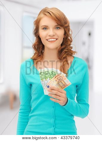 picture of happy teenage girl with euro cash money
