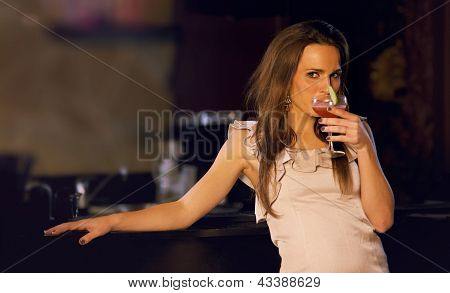 Sensual Woman Sipping Wine
