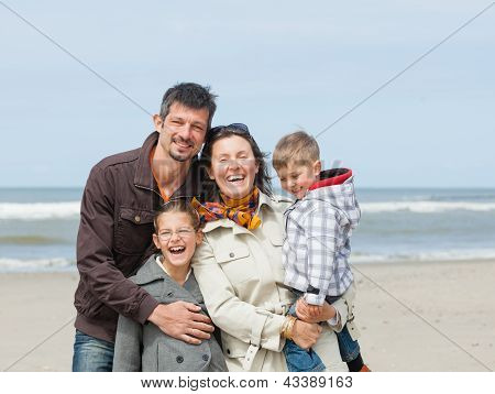 Family on the beach in summer