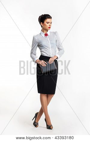 Serious Businesswoman Accountant - Fashion Model With Notepad