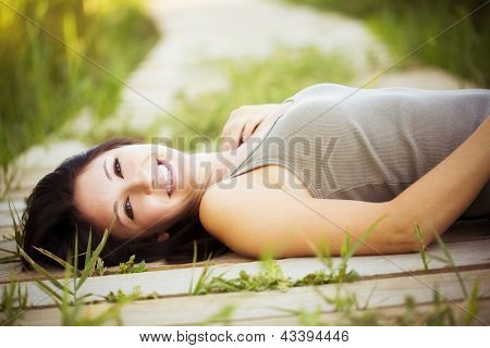 Young beautiful girl lying in nature.