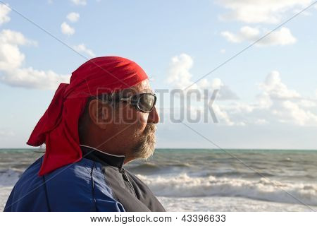 Profile of bearded man by the sea