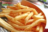 stock photo of french fries  - French Fries a Golden Fast Food Meal Snack - JPG