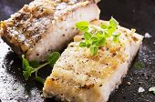 image of grouper  - fish fillet fried in the pan - JPG