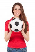 stock photo of debonair  - Athletic girl in a red shirt holding a soccer ball - JPG