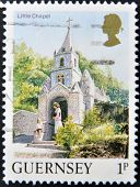 A stamp printed in Guernsey shows a little chapel