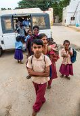 THANJAVUR, INDIA - FEBRUARY 14: unidentified School children get off the bus February 14, 2013 in Th