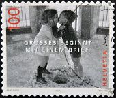 A stamp printed in Switzerland shows image to two boys kissing great start with a brief