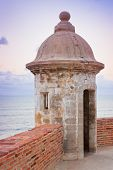 stock photo of el morro castle  - Lookout tower at El Morro Castle fort in old San Juan Puerto Rico at sunset - JPG