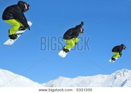 Sequence Of Snow Boarder Jumping