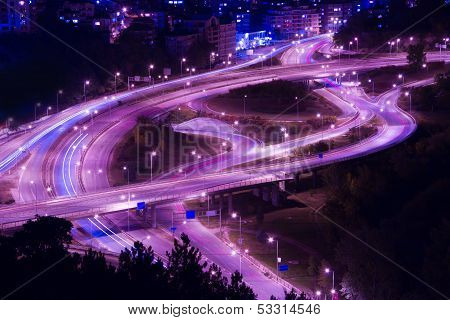 Abstract Lights From Cars On Road Junction With Bridge
