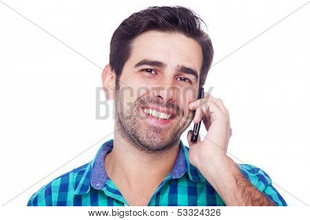 Handsome latin man talking on cell phone, isolated on a white background