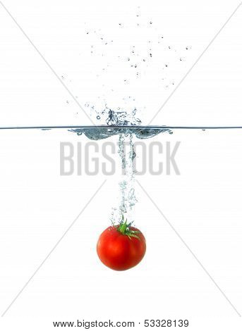 Fresh Red Tomato Fruit Sinking In Water