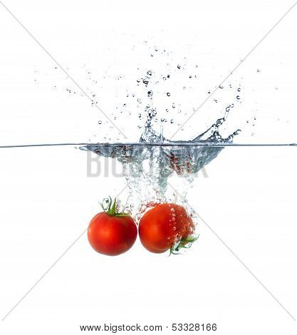 Red Tomato Fruits Sinking In Water