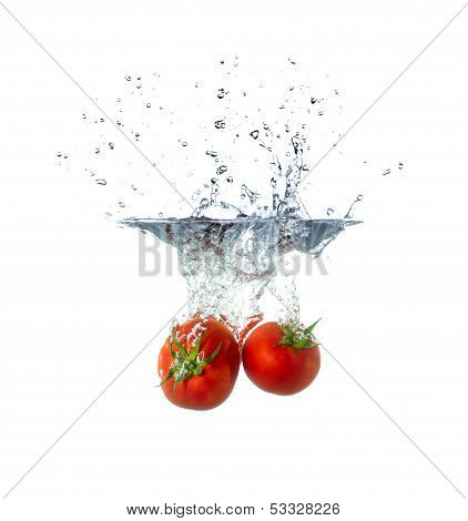 Fresh Tomato Fruits Sinking In Water