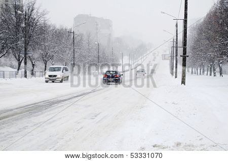 Cars Traffic On Snowy Roads