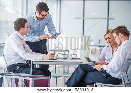 Managers at meeting in modern office