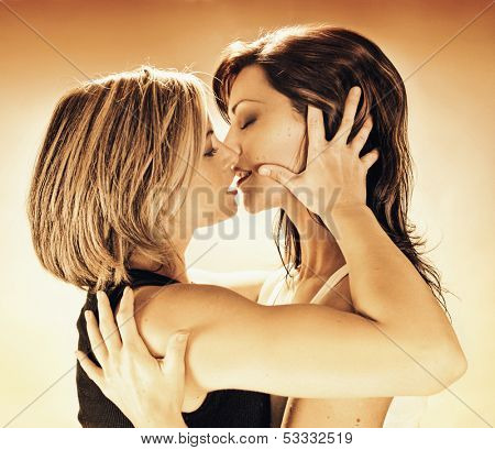 two women about to kiss each other