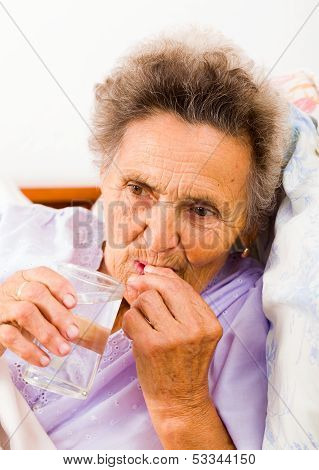 Elderly Taking Pills
