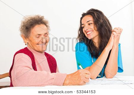 Nurse Helping Elderly Register For Nursing Home