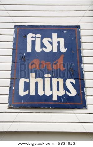 Weathered Fish And Chips Sign At Seaside